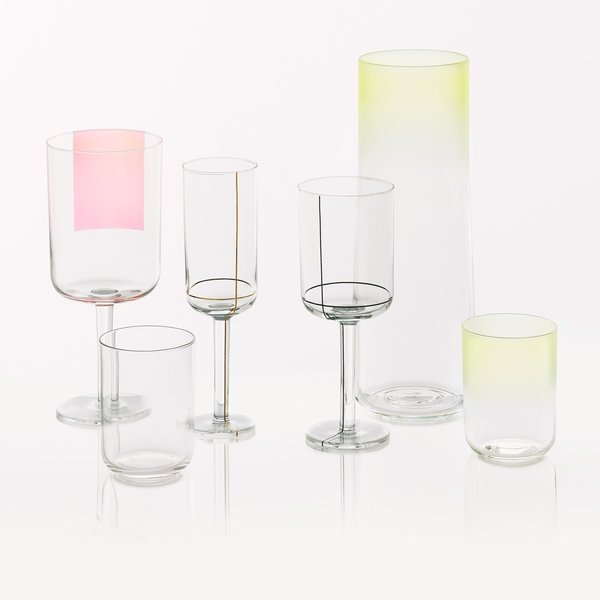 Serve festive cocktails...  COLOUR GLASSFrom the design duo Scholten & Baijings for Hay comes the Colour Glass collection. Using a unique language of color, form and line, the Colour Glass system employs a distinctive visual cue for each type of glass: gold lines to signify sparkling wine, a swath of pink to reference red wine, gold dots and color gradients for water. Combined with other pieces from the Colour Glass collection, a rich interplay of color and line is formed.