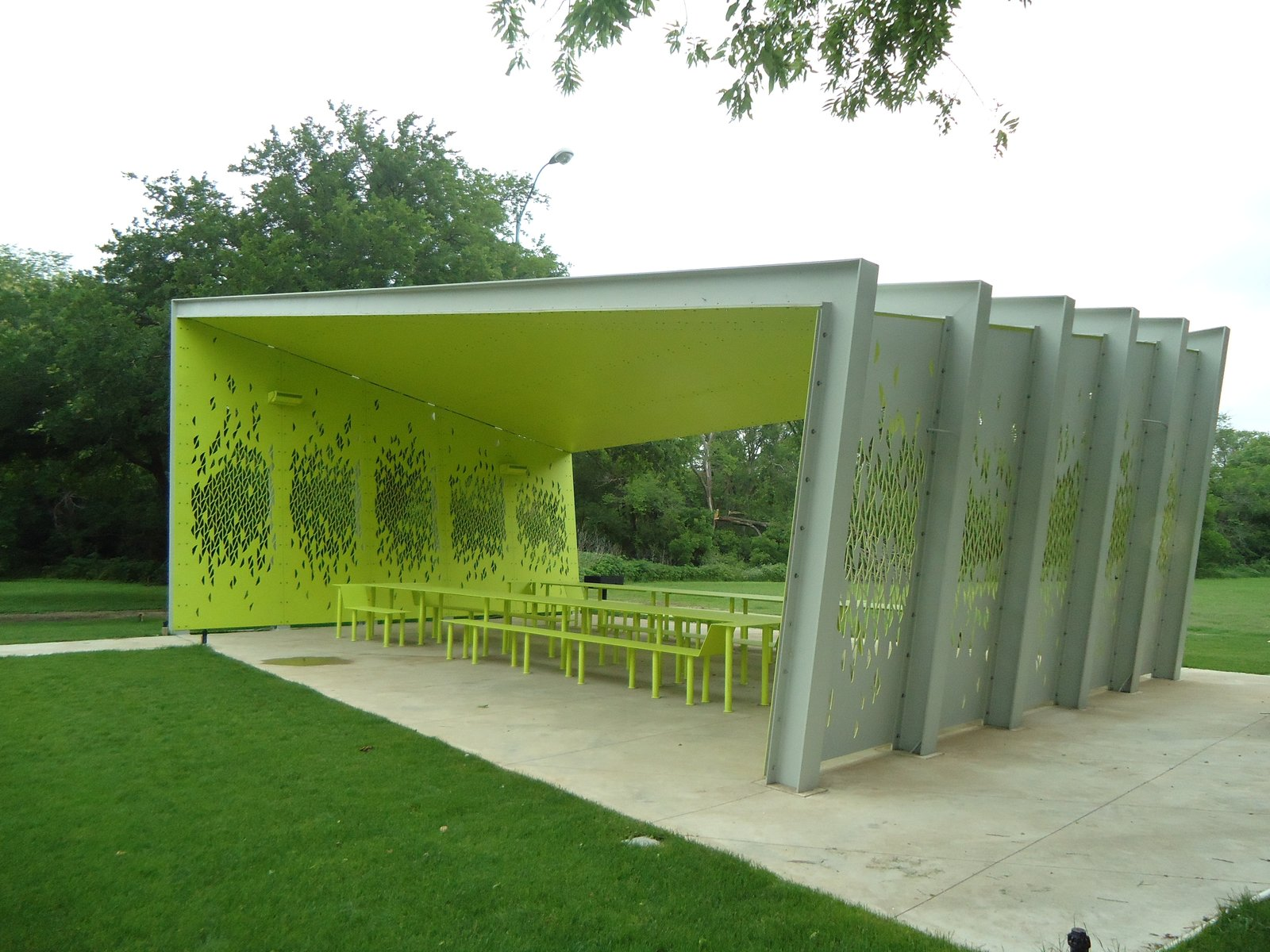 "The arresting lime-green interior makes the pavilion at once blend with and stand out from its surroundings. Photo by Architexas.  Search ""limegreen"" from A Modern Park Pavilion Rises in Dallas"