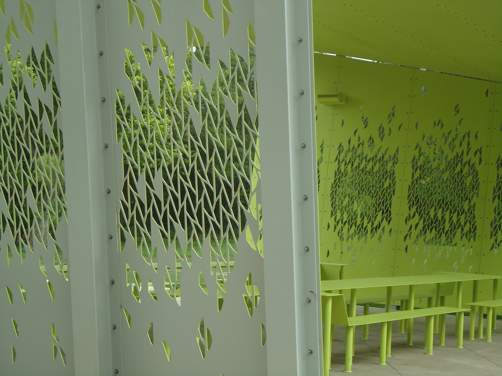 A leafy pattern, carved by a water-jet cutter, allows views through the sides—an aesthetic touch that doubles as a nod to security in the park, where crime has been an issue. Photo by Architexas.  Uses of Perforated Metal by William Lamb from A Modern Park Pavilion Rises in Dallas