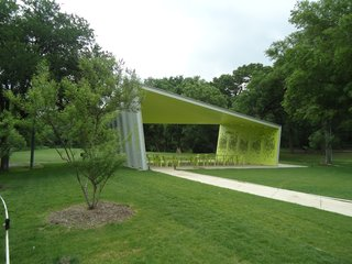 The pavilion sits in a clearing amid pecan, oak and mesquite trees. Photo by Architexas.