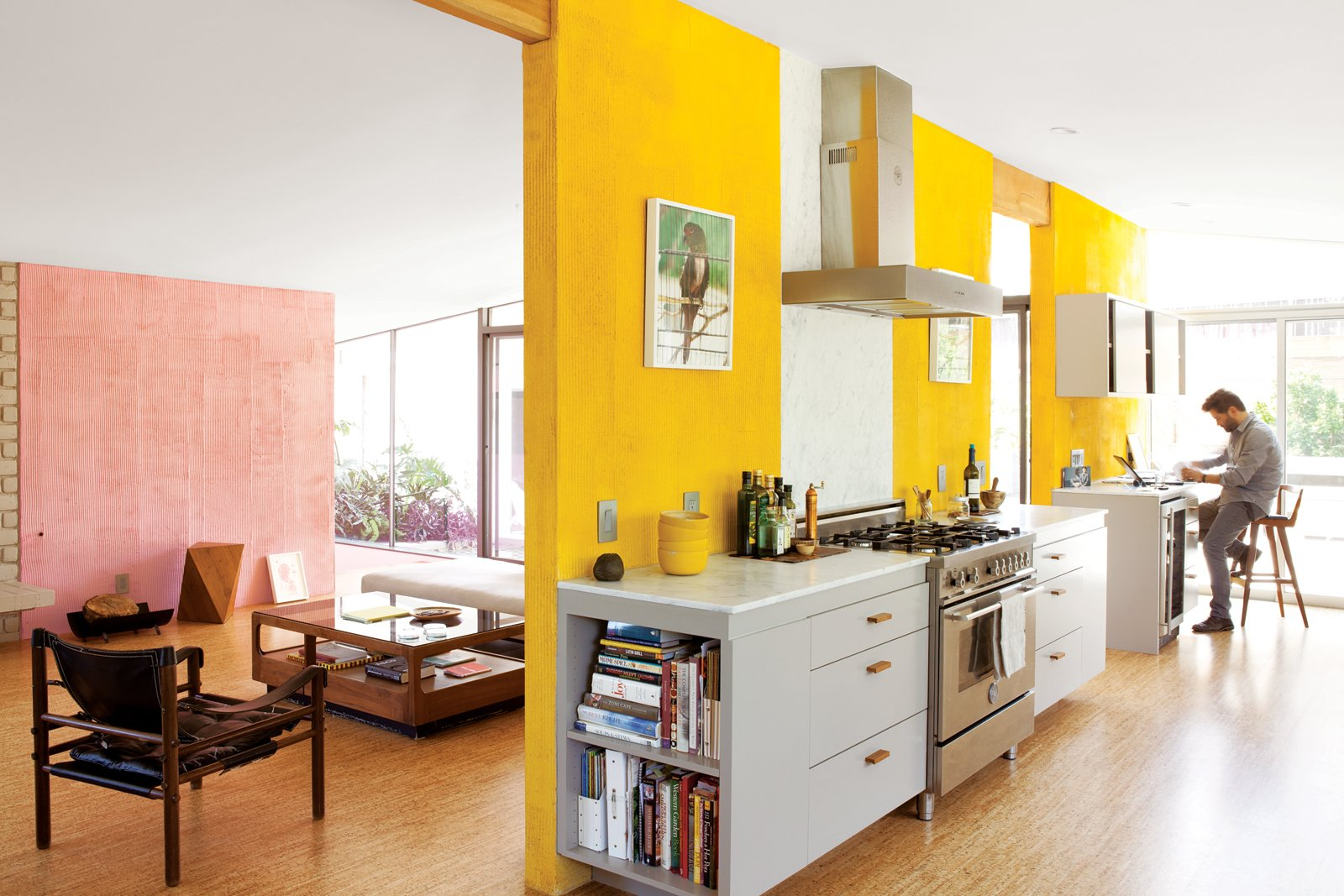 Kitchen, White Cabinet, Range, Range Hood, and Marble Counter How a highly productive collaboration among a trio of creative Angelenas—and a good dose of Barragán—turned a dark and beleaguered midcentury house into a family home for the ages. Photo by Lisa Romerein.  Interior Inspiration: 5 Bold Ways to Use Color by Jaime Gillin from A Fresh Dose of Color Livens Up This Midcentury Los Angeles Home