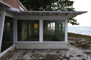 """The house was located approximately fifty feet from the Gulf of Mexico, which resulted in """"substantial weather- and flood-related damage"""" over its sixty-six year life span. Photo by Chris Mottalini."""