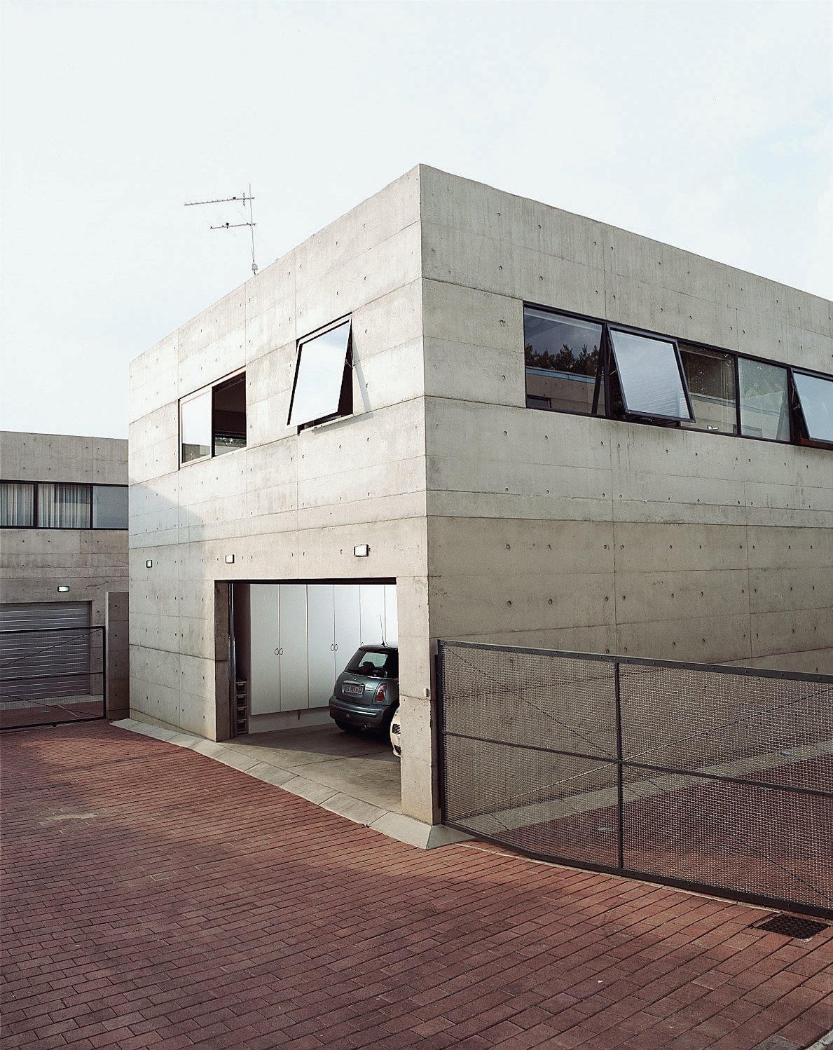 Great modern garages collection of 8 photos by erika heet for Above garage apartment for rent near me