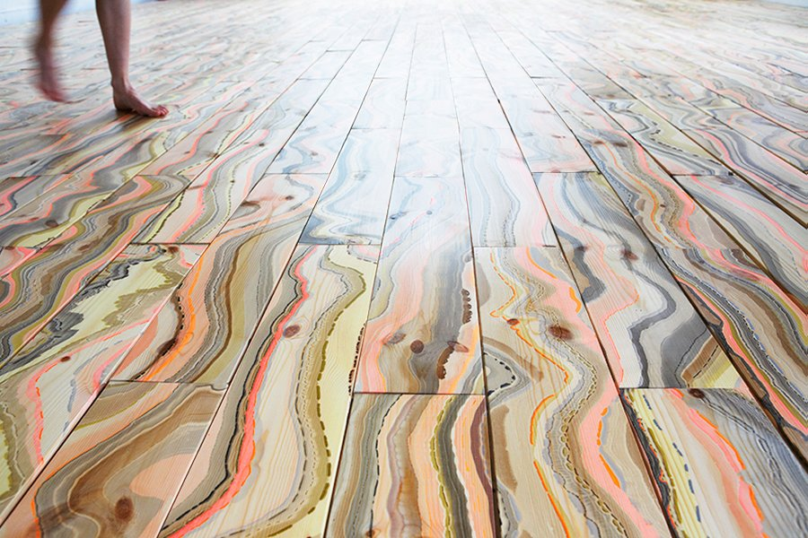 "Pernille Snedker Hansen has repurposed an old marbling technique giving Nordic wood a supernatural, organic, colourful and vibrant pattern. The wooden planks for ""Wave"" are made one by one, and thus each floor board acquires a unique pattern of coloured stripes.  Photo 5 of 9 in Four Danish Designers You Need to Know Now"