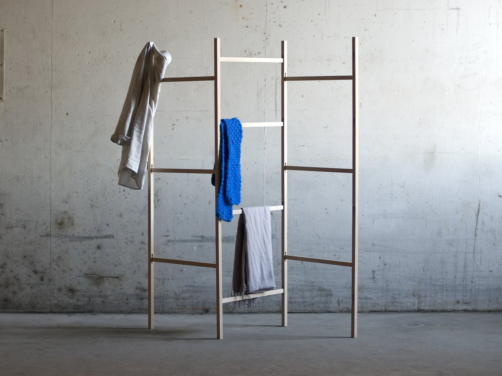 Another minimalist clothing rack by Jakob Jørgensen, a frequent collaborator with Line Depping, comprises a simple wedge assembly that attaches a horizontal element to a vertical load-bearing element.  Photo 8 of 9 in Four Danish Designers You Need to Know Now