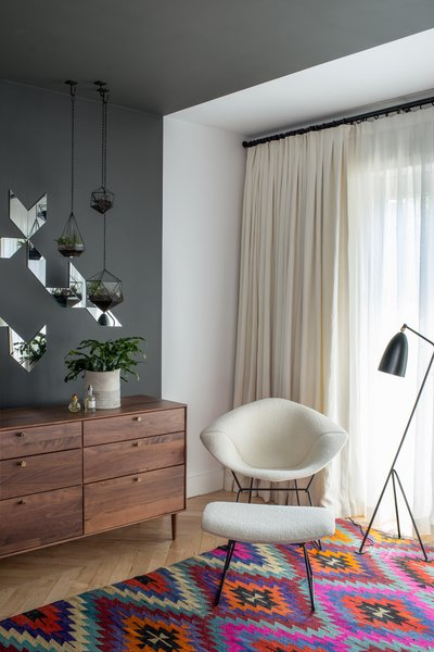 Organic comfort meets modern functionality in the Grasshoper Lamp. In a corner of this Brooklyn Brownstone, a black Greta Grossman Grasshopper lamp sits next to a Bertoia Diamond chair with matching ottoman.