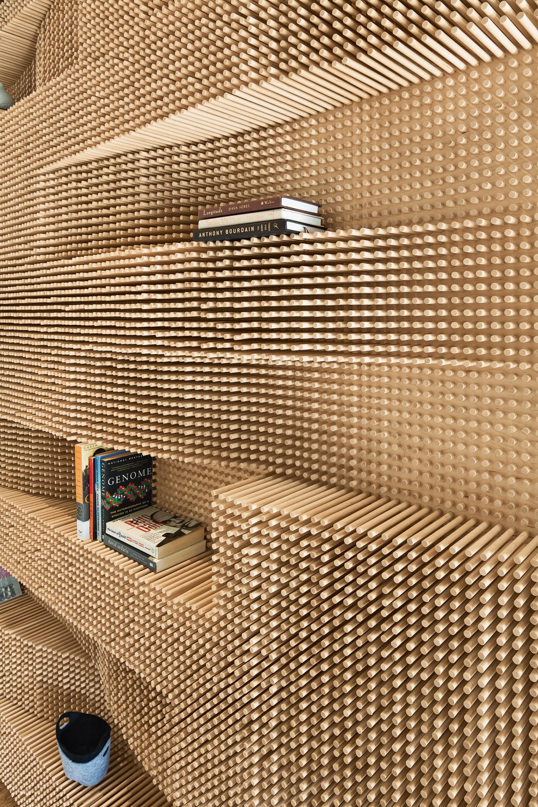 CATCH A WAVE  An undulating wall made from over 40,000 dowels adds a dose of awe to a Massachusetts loft.  photos by: John Horner  Storage by Dwell from Catch A Wave