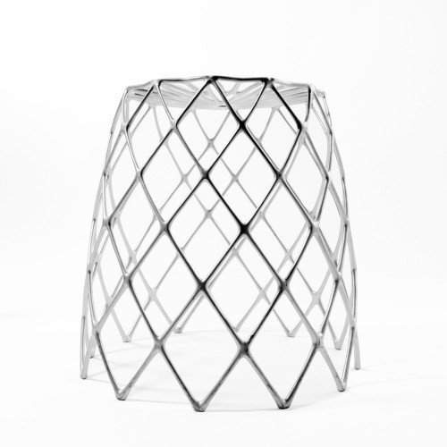 KAKTUS STOOL  This sturdy stool is inspired by the delicate filigree of the Staghorn Cholla cactus. Designed by the architect and co-founder of Artecnica Enrico Bressan, the Kaktus stool is a contradiction in form: lightweight aluminum gives the appearance of airiness and fragility but is entirely weight-bearing.