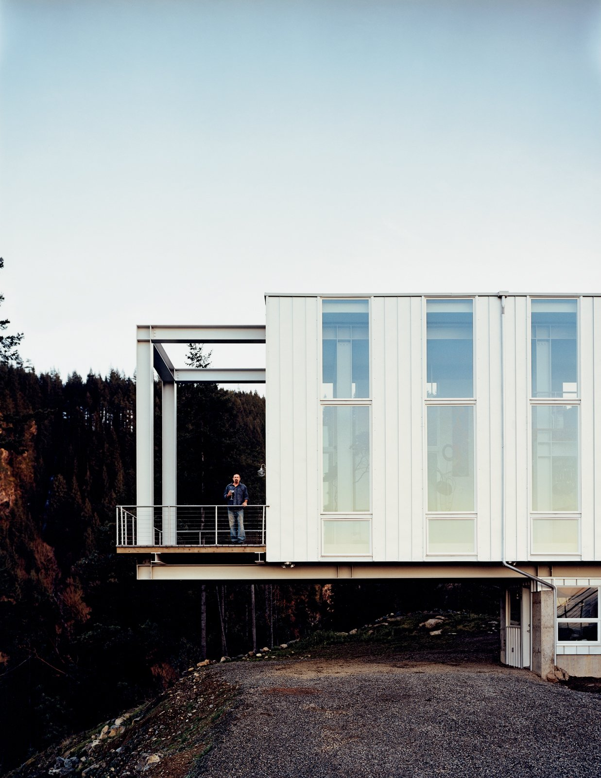 """Architect Peter Anderson explains that """"the floating nature of the design would not have been possible with conventional onsite framing techniques, nor any of the currently marketed modular home designs."""" Using a heavy structural steel frame, engineered wood spline beam system, and structural insulated panels, the architects created a truly unique hybrid structural system and, in the end, a home.  Modern Spaces in the Pacific Northwest by William Lamb from On a Rock in a Hard Place"""