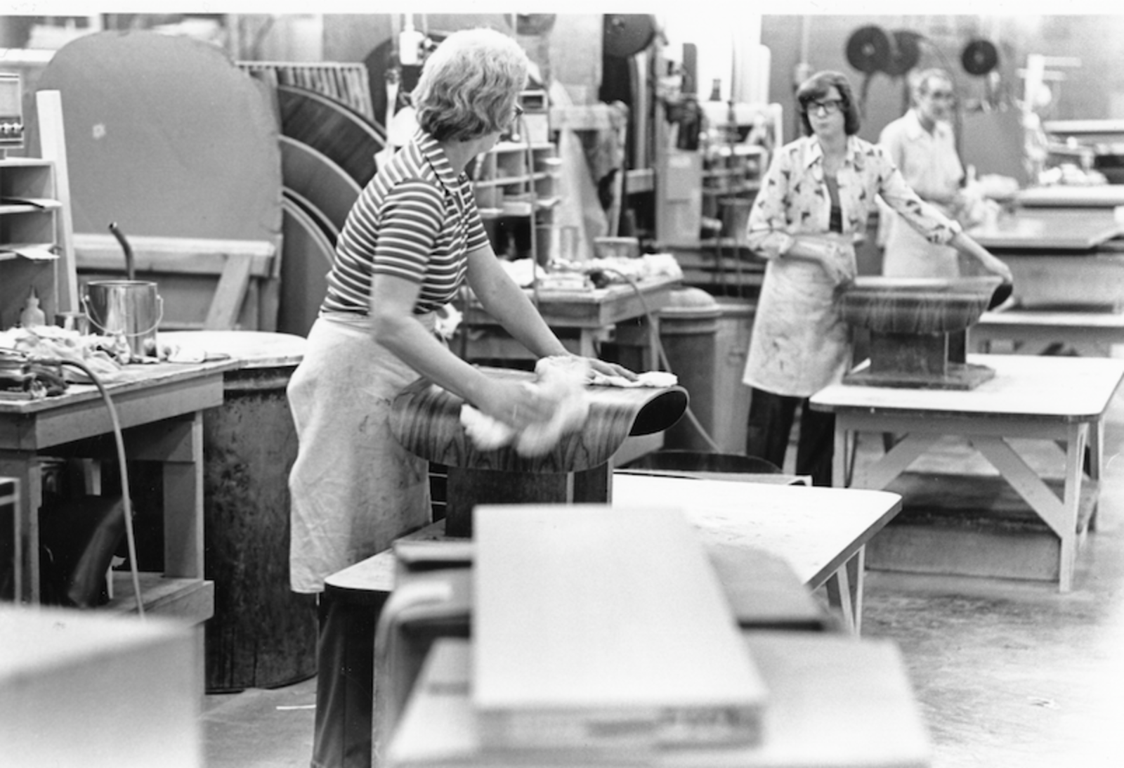 Employees at the Herman Miller factory polish the molded plywood shells in the seventies.  Photo 4 of 10 in The History Behind America's Favorite Chair: The Eames Lounge and Ottoman