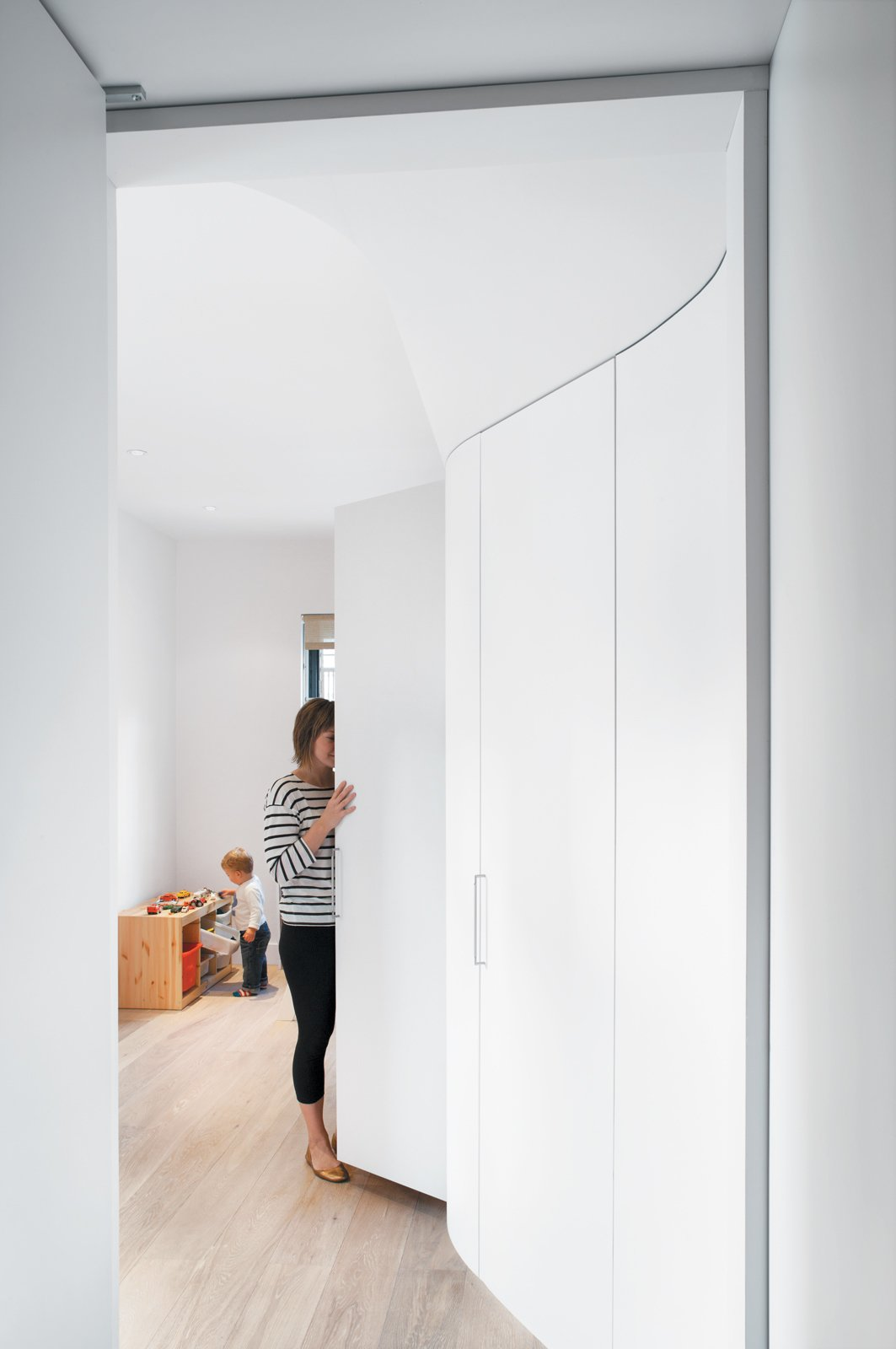 """Their parents' seldom-needed stuff (luggage, winter clothes) is stashed in the higher cabinets. """"Believe it or not, we have empty cabinets,"""" says Nikolova. """"There's space for everything.""""  Storage Solutions: 7 Hidden Closets by Diana Budds from All Together Now"""