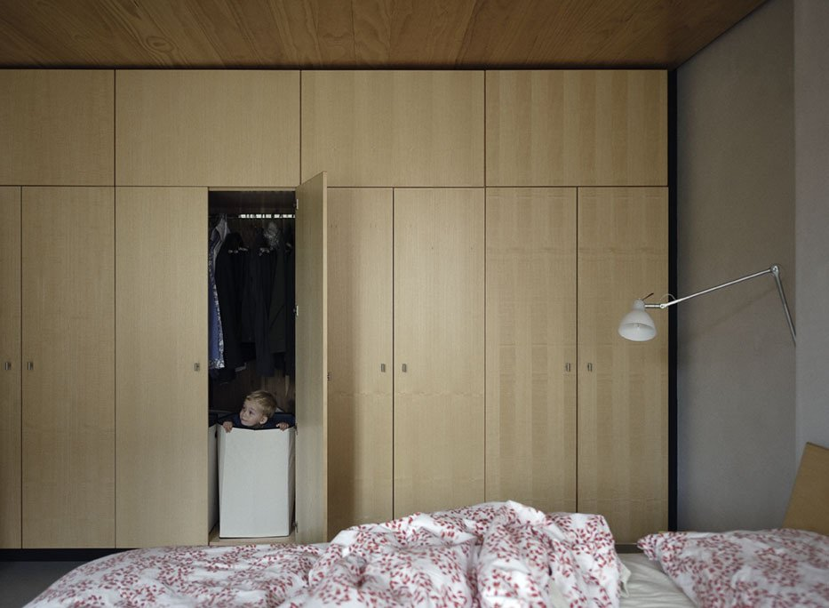 Bedroom, Bed, and Wall Lighting Paul finds a hiding place amongst the bedroom built-ins.  Storage Solutions: 7 Hidden Closets by Diana Budds from Family Home Renovation in Brooklyn