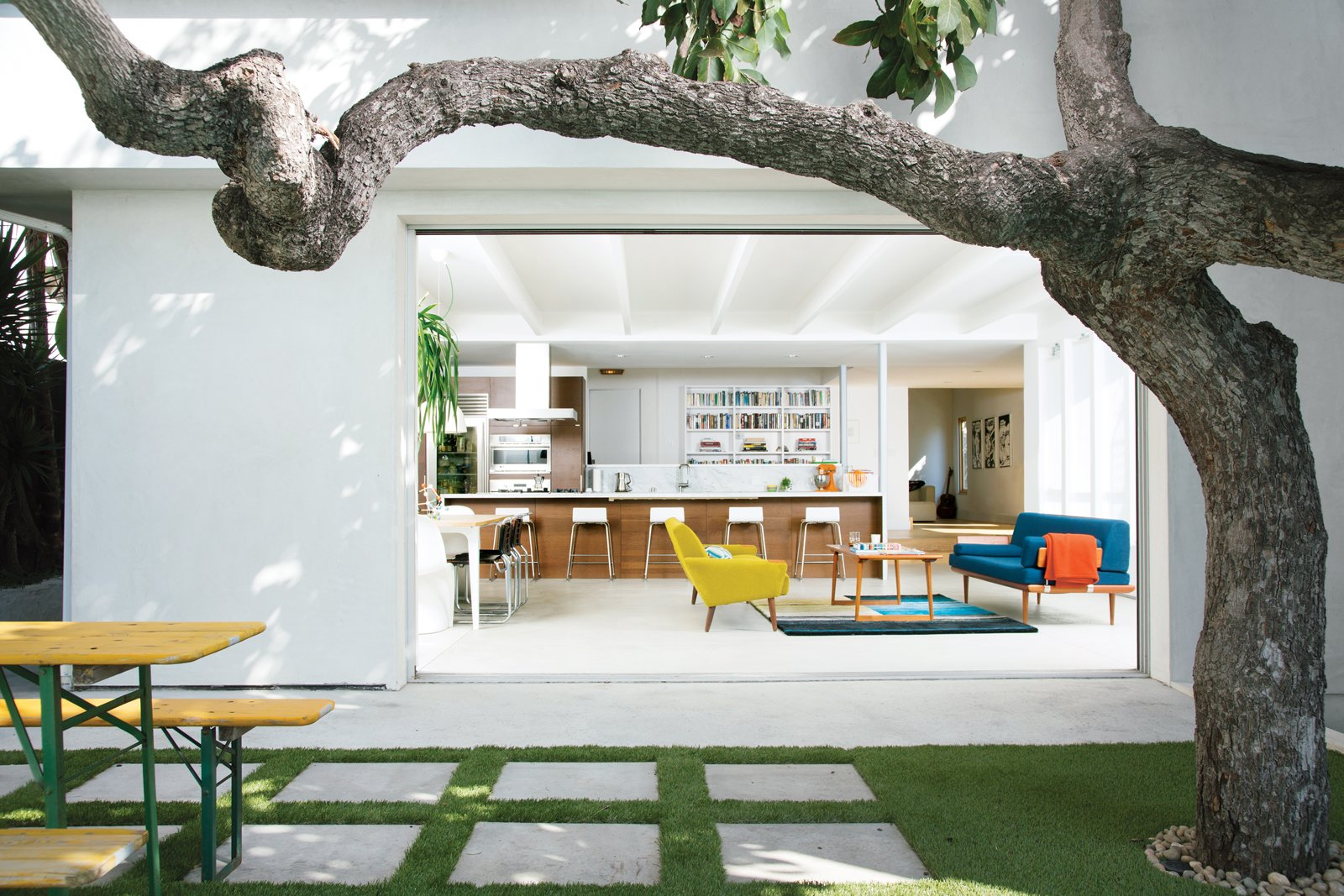 Outdoor, Grass, and Pavers A mature avocado tree shades the hardscaped patio located just outside the great room.  Best Outdoor Pavers Grass Photos from The Modern Renovated Home of Glee Star Jayma Mays