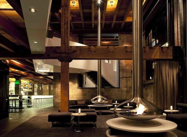 TWENTY FIVE LUSK  Restaurant designed by CCS Architecture  This restaurant in the SoMa neighborhood of San Francisco transformed a former meatpacking and smokehouse facility while leaving hints of the warm brick and aged wood beams.  Modern Designs Featuring Exposed Beams by Megan Hamaker