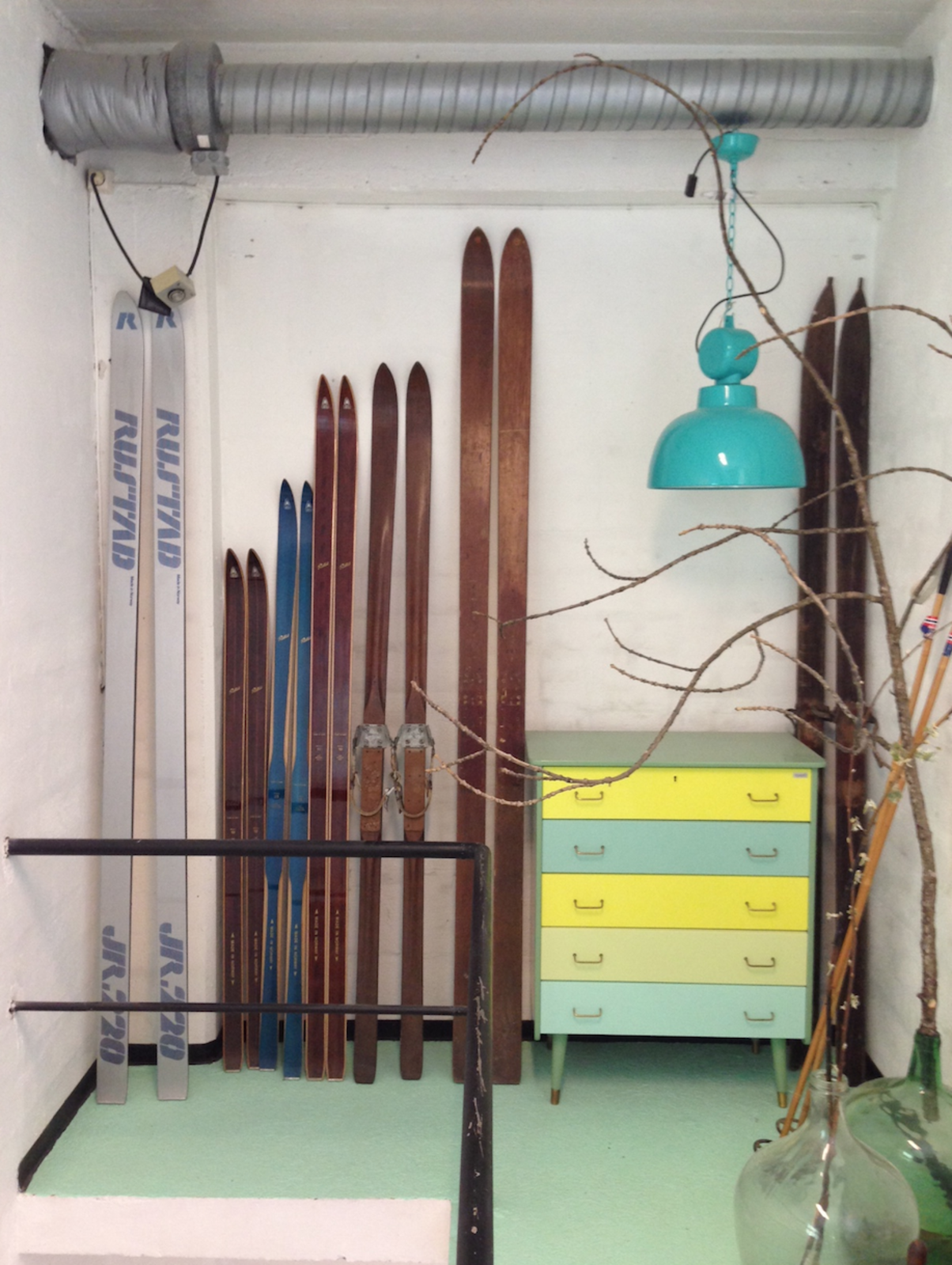 Old wooden skis mark the entrance of Ment's showroom, which occupies on the factory of the world's oldest ski manufacturer.  Photo 2 of 7 in Norwegian Ceramics Studio in an Old Ski Factory