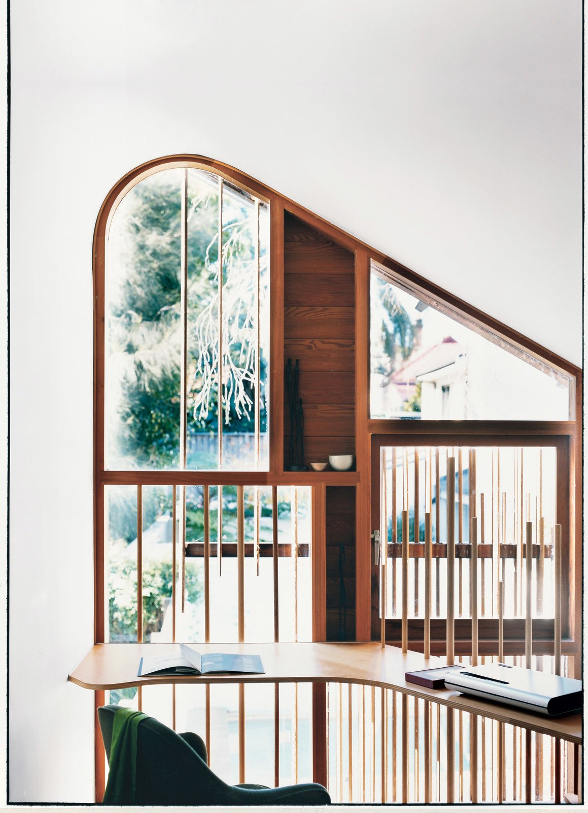 Office and Study Room Type The delicate wooden dowels, used both on the exterior facade and the mezzanine level balustrade, are nods to the bamboo fences traditionally found in tea gardens.  Photo 4 of 8 in Almost Perfect