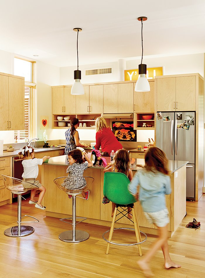 Kitchen, Wood Cabinet, and Pendant Lighting Gliss swivel stools and a Dowel bar stool share space in front of a custom maple kitchen island. The pendant lamps are by Lightolier.  Photo 3 of 11 in Modular Compound is the Ultimate Retreat for Three Generations