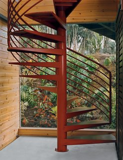The spiral stairs were fabricated in the Bay Area and shipped in the same container as the furniture.