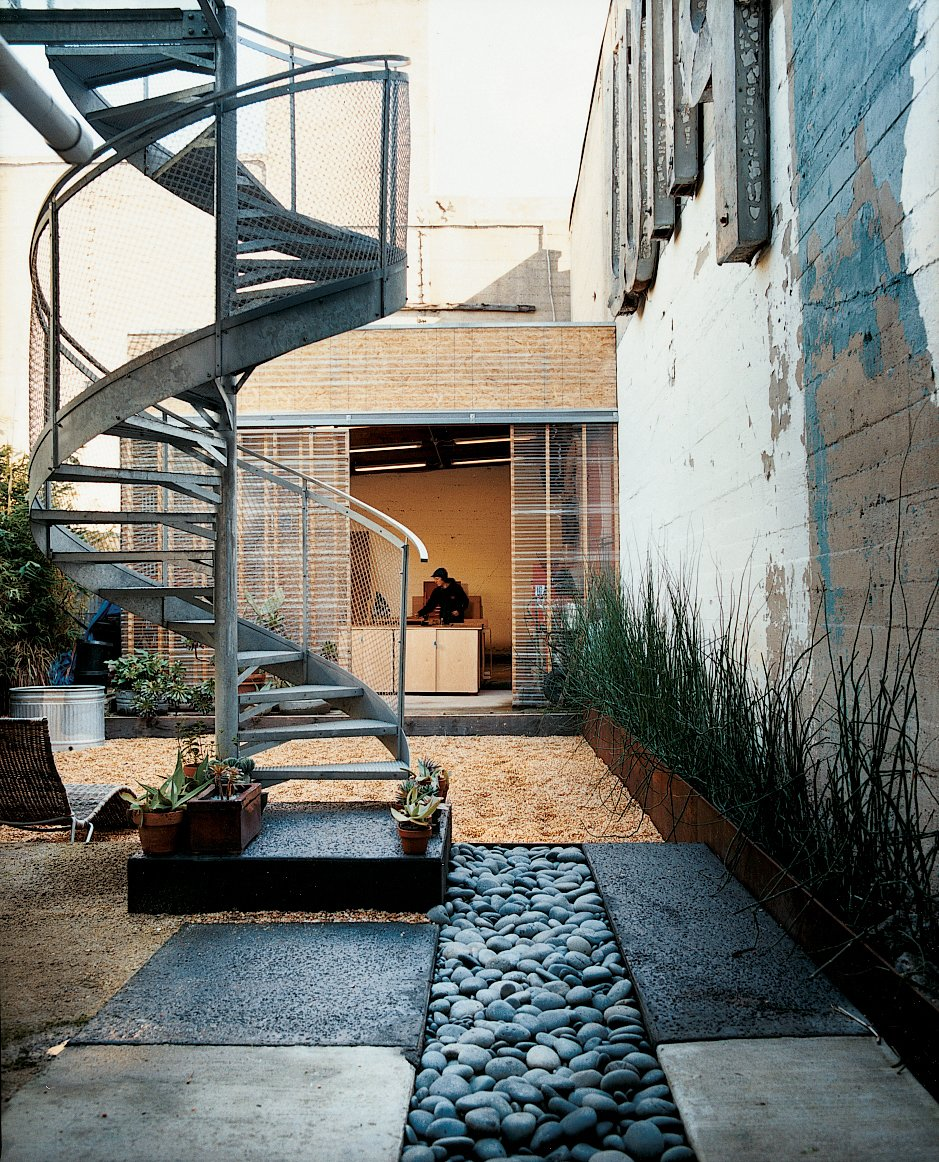 A spiral staircase descends from the glass deck to the rain garden, which replaced a concrete pad.  190+ Best Modern Staircase Ideas