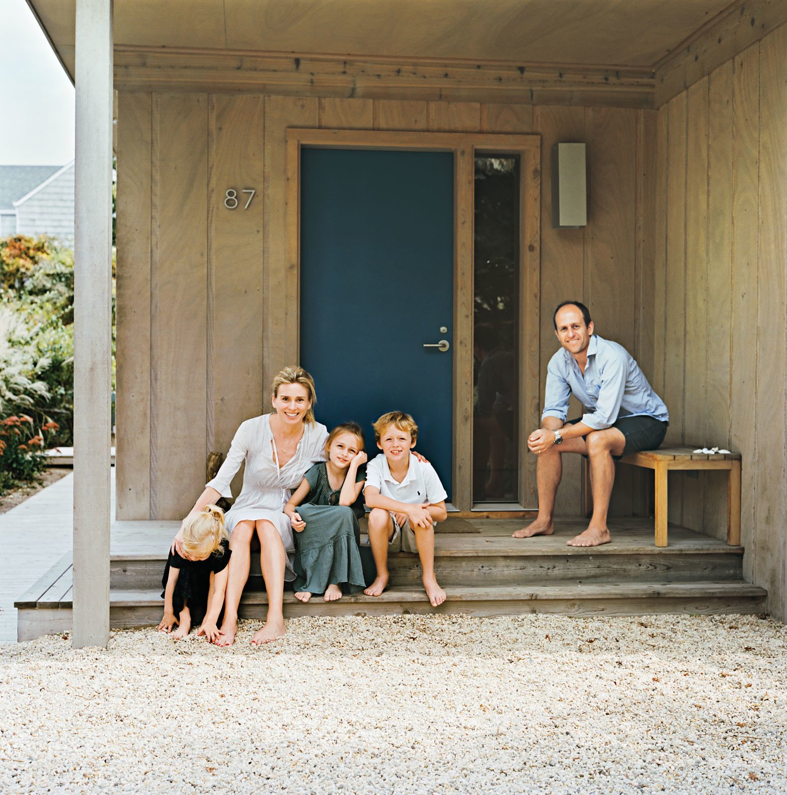 Doors, Exterior, Wood, and Swing Door Type The color of the Fishers' front door was inspired by an old Land Rover Defender's hue, which Charlie had Benjamin Moore custom-match.  Photos from Long Island Found