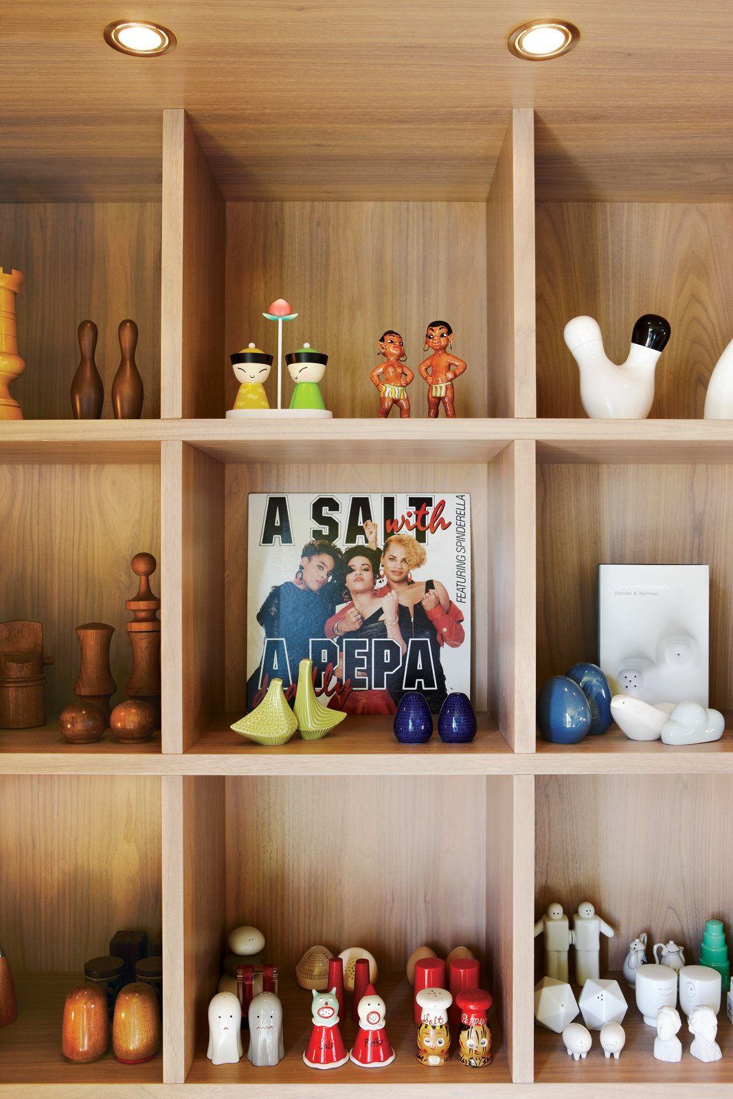Storage Room and Shelves Storage Type Montague arranges his objects with a sense of humor. Custom shelves display his collection of salt and pepper shakers.  Photo 8 of 15 in Party-Friendly Apartment in Toronto