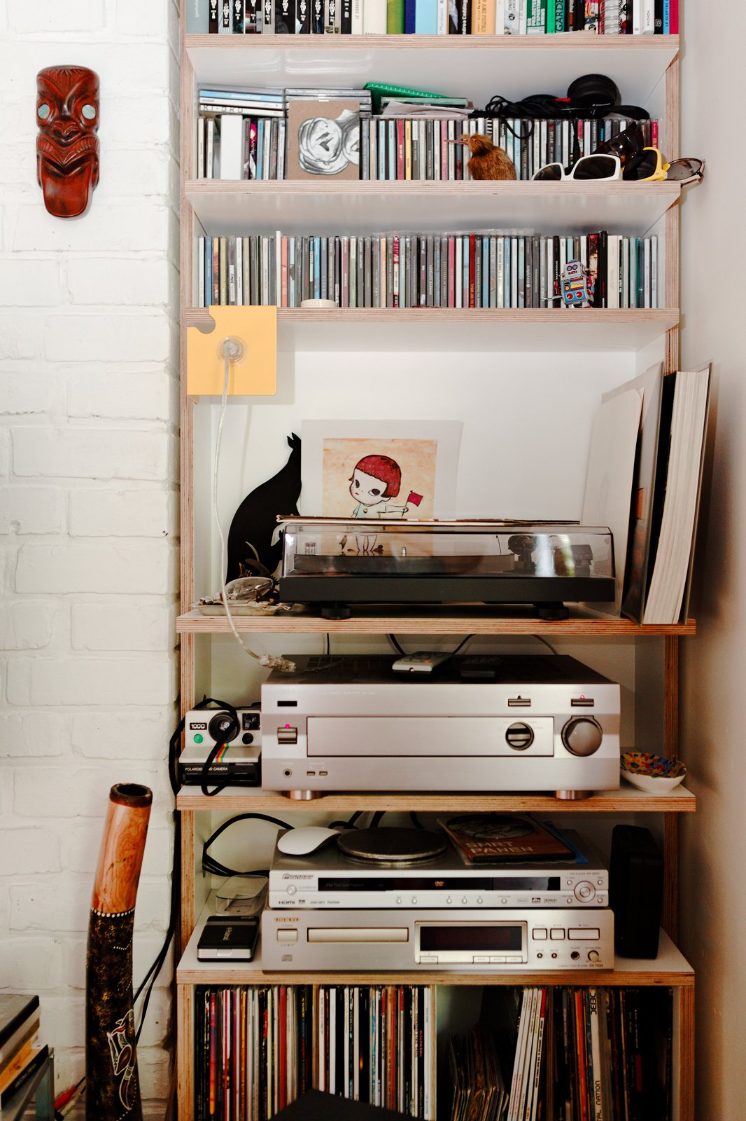 Much of the charm of this small, affordable space is its sense of careful clutter. The stereo, LPs, and CDs only add to the sense that this flat was designed for living, not as some airless showpiece.  Photo 6 of 8 in A Little Apartment Gets a Solid Renovation