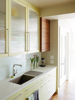 Much of the cooking and cleaning takes place at the rear counter, which is outfitted with an Evoke faucet by Kohler.