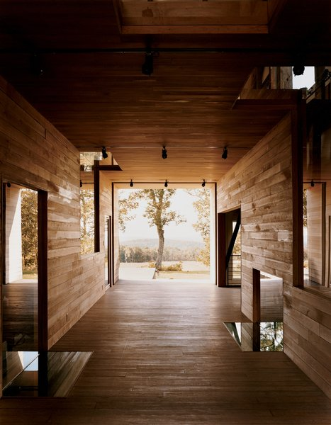 """In a narrow residual area between the breezeway and the house's northern elevation, Cohen created a so-called """"skinny space,"""" with a changing area accessible to the outdoor shower.  Best Photos from Raising the Barn"""