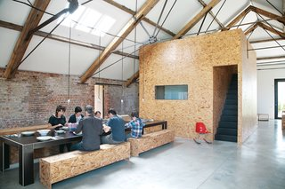 These wood-wrapped spaces take oriented strand board to new heights.