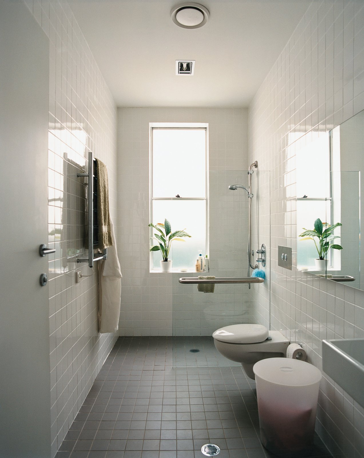 The bathroom's width and reinforced handrails accommodate Wansbrough's needs.  Bathroom