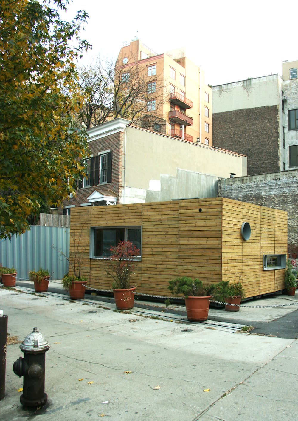 Exterior, House, Shipping Container, and Wood The sleek 320-square-foot MEKA home, designed by Jason Halter and Christos Marcopoulous, when it was set up in New York. The home is made of cedar paneling, set over a steel shipping container.  Exterior House Wood Shipping Container Photos from Inexpensive, Easy-Assembly Shipping Container Home
