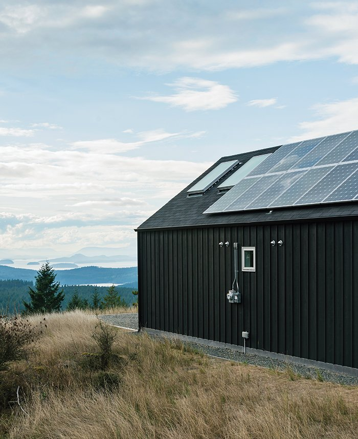 Exterior, House Building Type, and Wood Siding Material A panorama of sylvan hills and ocean views surrounds artist Richard Brothers's environmentally minded Orcas Island, Washington, home.  Cabins & Hideouts from Idyllic Home Designed for an Artist