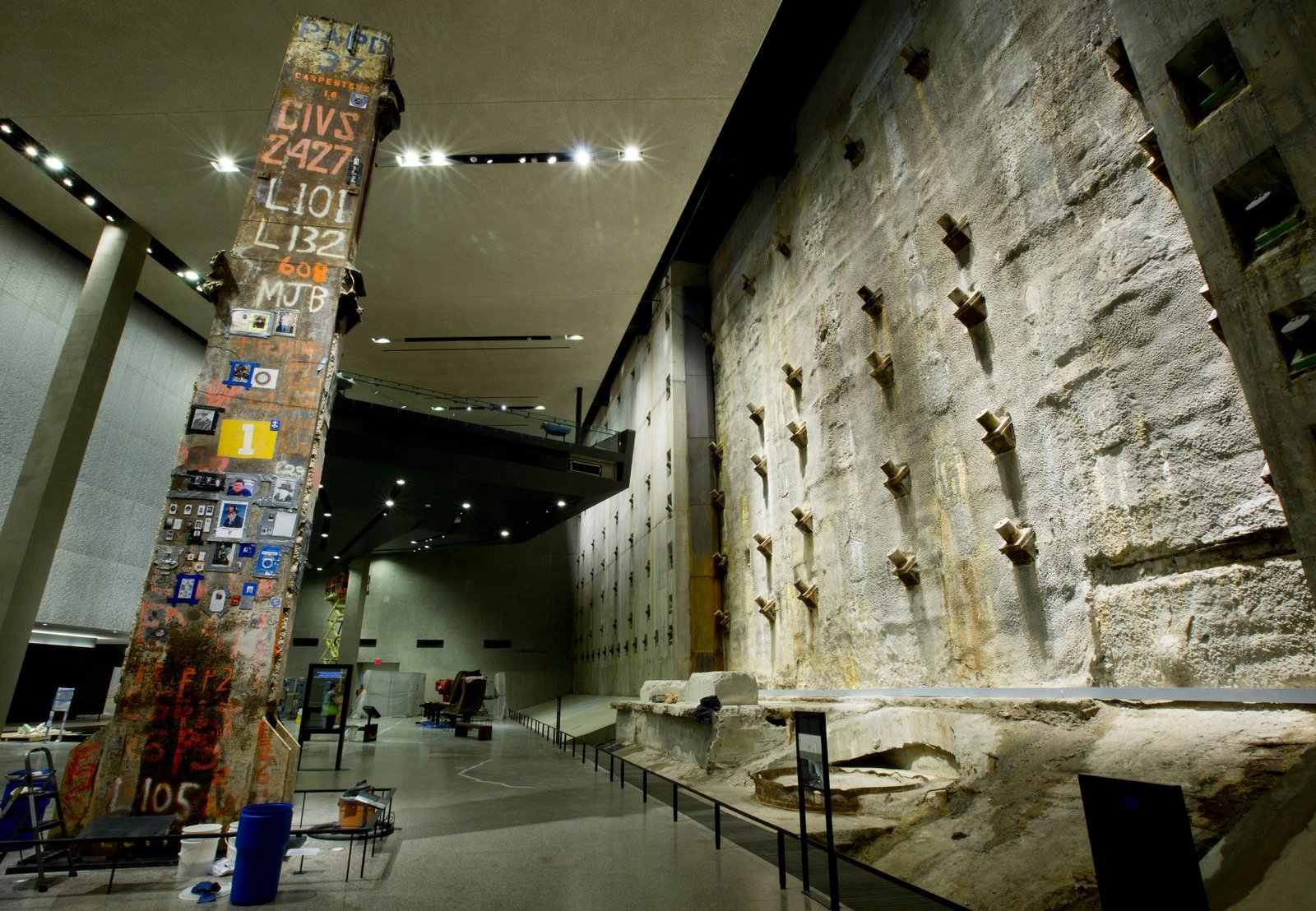 Column No. 1,001B, the last section of World Trade Center steel to be removed from Ground Zero, stands 37 feet tall next to the slurry wall inside the National September 11 Memorial Museum, designed by Davis Brody Bond. The museum opened in May.  Photo 1 of 14 in At Ground Zero Bedrock, the 9/11 Museum Prepares for Visitors