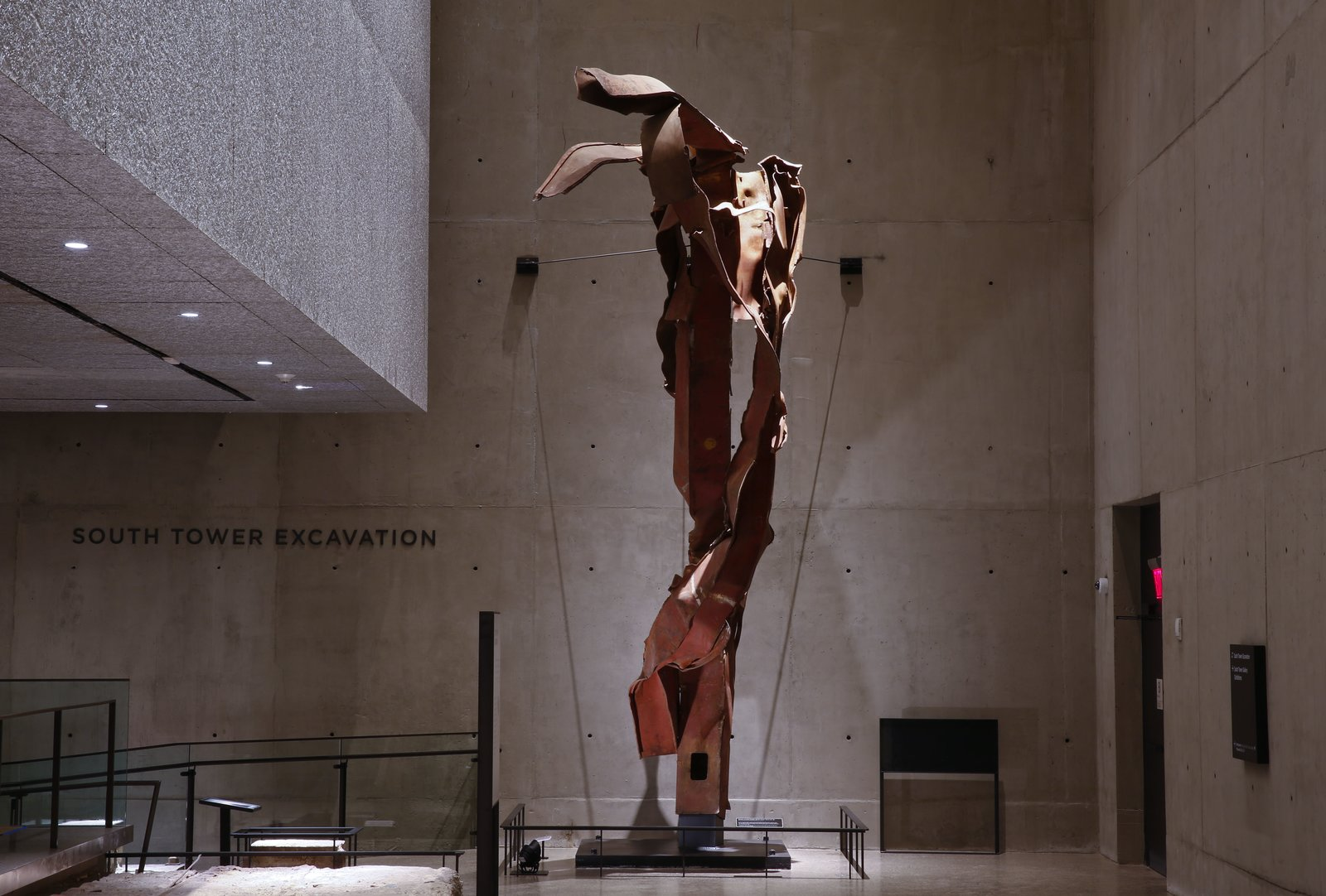 """A section of """"impact steel"""" from the World Trade Center is on display outside the footprint of the South Tower inside the National September 11 Memorial Museum.  Photo 8 of 14 in At Ground Zero Bedrock, the 9/11 Museum Prepares for Visitors"""