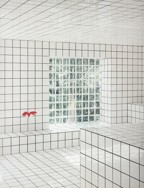 The grid pattern ebbs and flows in popularity in art and fashion as well as in design. Artist Jean-Pierre Raynaud is famous for his home in Paris, La Maison in La Celle-Saint-Cloud, which sported an interior composed almost entirely of 15-centimeter-square white tiles, evenly spaced out with black grout.