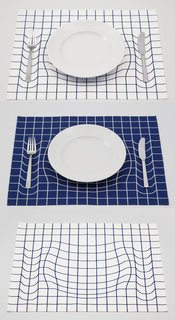 "AP Works of Japan created this playful placemat, which uses an illusion to make it seem ""as if the pattern has sunk under the weight of tableware."""