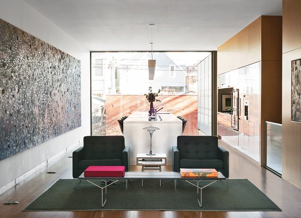 The artwork extends nearly the length of the entire north-facing wall of the living-dining-kitchen area, which overlooks the back courtyard and the garage.