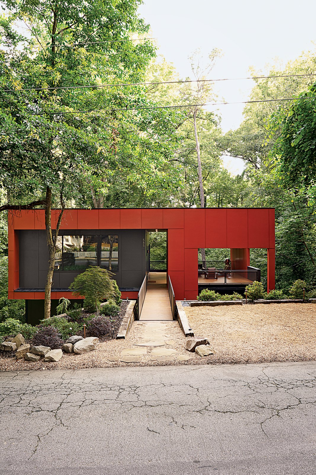 Exterior, House Building Type, and Flat RoofLine A bridge spans the home's steep site for street access.  Radical Red Houses by Erika Heet from An Affordable Modern Home in Atlanta