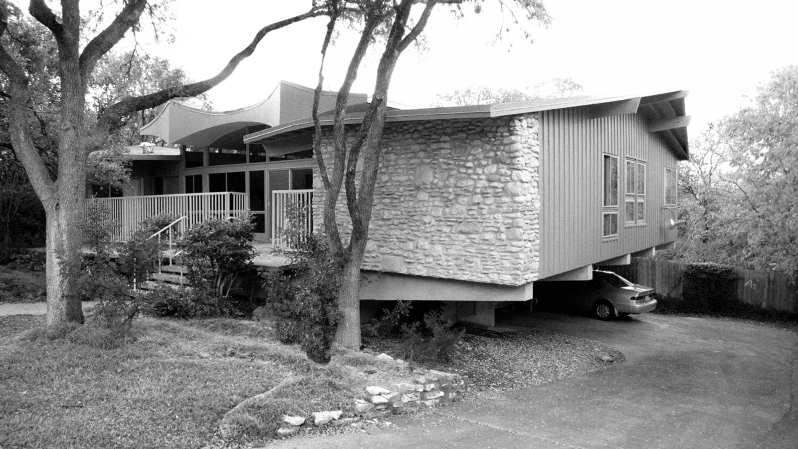 Architect A.D. Stenger designed and developed scores of houses in Austin, Texas, including this one, whose Jetsons-esque facade is rumored to reference the aeronautics classes he took in college.  Mid Century Modern Austin from A Renovated Midcentury Gem in Austin