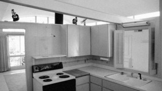 The architects ripped out the existing kitchen, bounded by walls that distracted from the openness of the original house.
