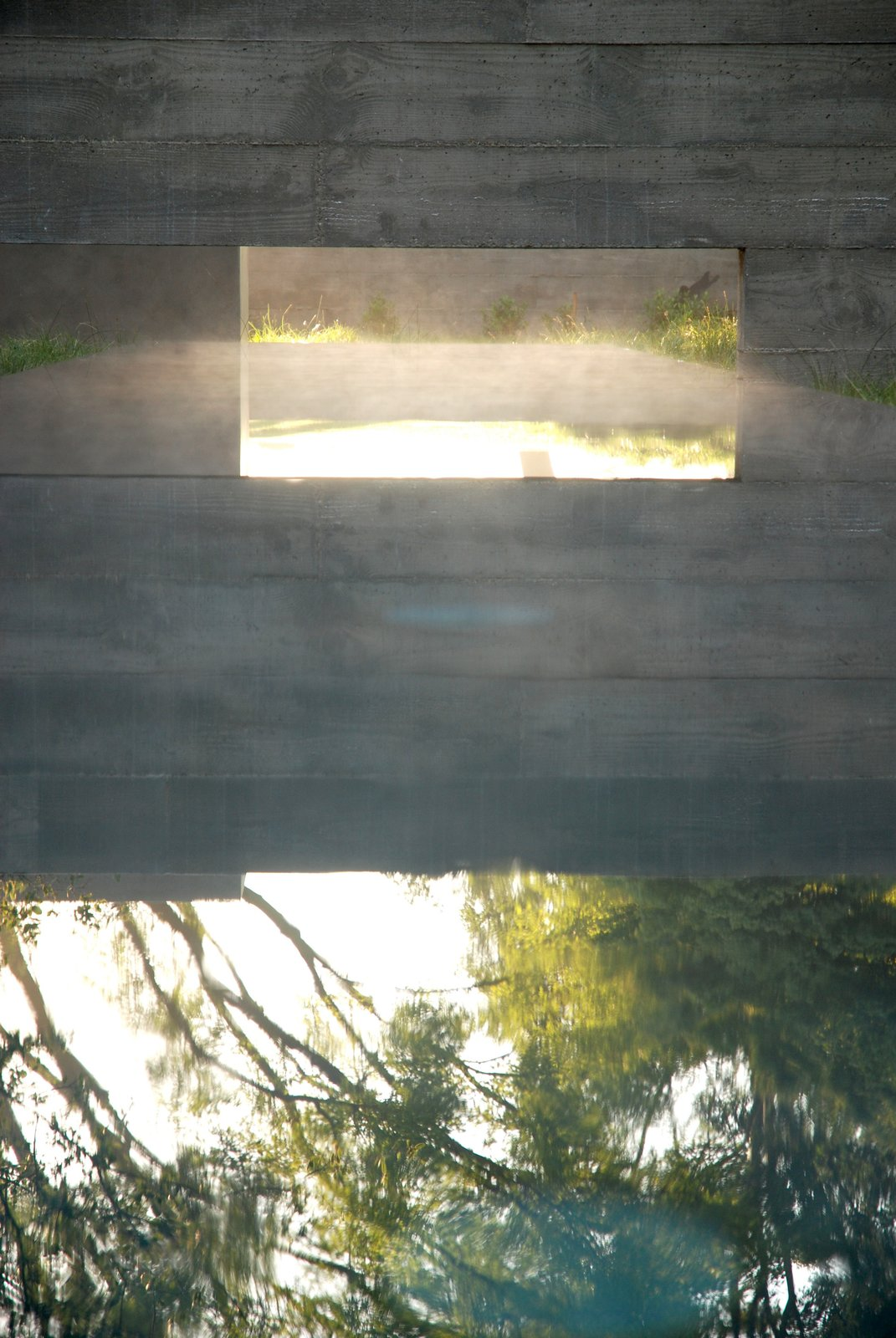 """A reflecting pool for a residence that Aidlin Darling designed in San Joaquin Valley, California. """"This rural residential project incorporates the agricultural vernacular language of California's Central Valley, including irrigation aqueducts and vastness of scale,"""" David Darling says. """"Landscape, materiality, and the cooling effect of water elements were paramount."""" Photo courtesy of the Sonoma Valley Museum of Art.  Photo 2 of 6 in Aidlin Darling Design Takes Over the Sonoma Valley Museum of Art"""