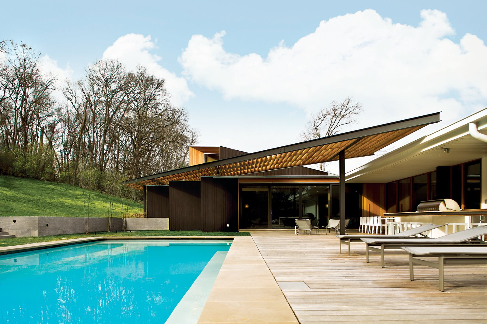 The Babat residence in Nashville is blessed with a big backyard; however, the blistering Tennessee sun once made it feel more like a broiler than a place to kick back and relax. Enter architect Michael Goorevich—then on staff at Manuel Zeitlin Architects—who devised a wood-and-steel trellis to cover part of the space. Tagged: Outdoor, Swimming Pools, Tubs, Shower, Large Patio, Porch, Deck, Wood Patio, Porch, Deck, Large Pools, Tubs, Shower, and Back Yard.  Backyard Daydream from The Trellis That Keeps It Cool
