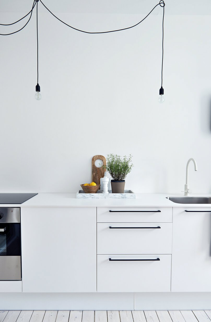 It's all white in this kitchen in Gothenburg, Sweden—from the floor to the cabinets to the fixtures. via fromscandinaviawithlove.com  Winter-White Kitchens and Bathrooms by Diana Budds