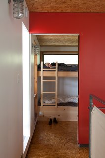 Soren and Annika share a lofted bedroom and a pair of bunks. In Barker and Inzunza's house, this space is used as an office and music room.