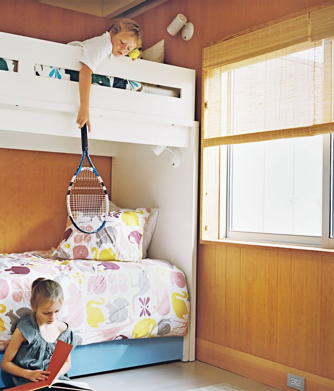 Kids, Bedroom, Pre-Teen, Bunks, Neutral, and Teen At the Fisher family's 1960s Long Island beach bungalow, the kids share a warm, bright space with modern prints. Photo by Richard Foulser.  Best Kids Neutral Bunks Photos from Cool Spaces for Kids