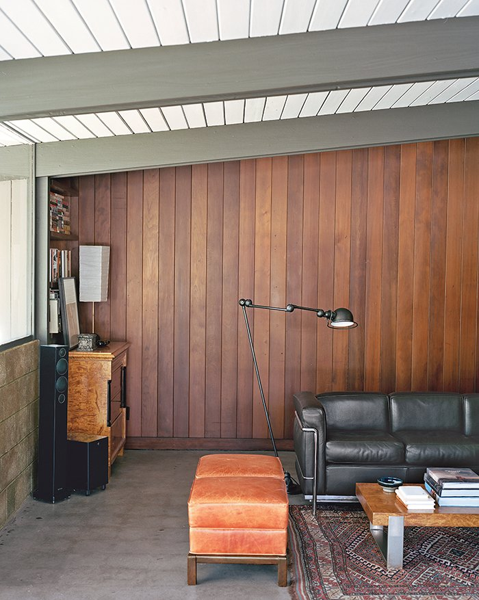 "Living Room, Sofa, and Concrete Floor ""I believe Jones designed these houses to be living things. They're not museums,"" says architect and resident Bruce Norelius.  Photo 1 of 5 in These 5 Transformations Show Why Challenging Renovations Are Worth It from L.A. Renovation Respects Midcentury Bones (While Adding Some Flair)"