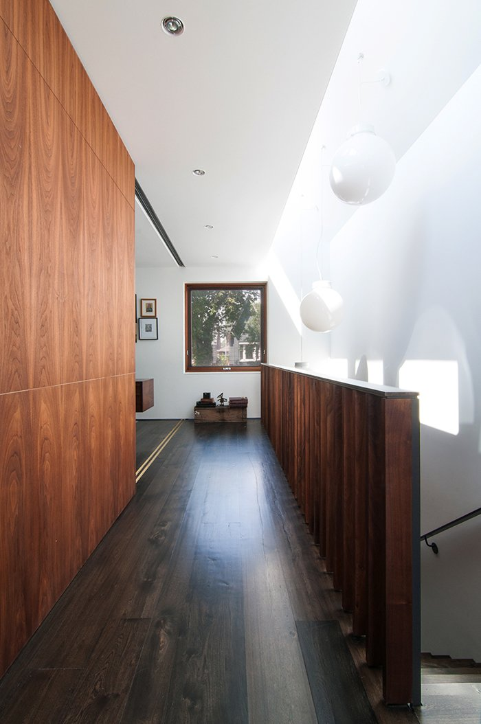 Hallway and Dark Hardwood Floor Windows in the roof monitor let in natural light and ventilation.  Lounge