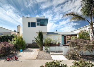 An Eye-Catching San Diego Addition with a Curved, Two-Story Garage Door