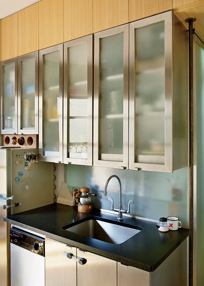 Kitchen, Undermount Sink, and Metal Cabinet Garber and Robertson replaced walls and doors with translucent Panelite, which draws sunlight deep into the apartment.  Photo 4 of 12 in Bright Renovation of a Tiny Manhattan Apartment