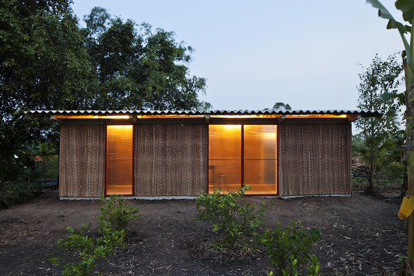 Vo Trong Nghia Architects utilized passive design strategies and a double roof, constructed from Nipa palm and corrugated cement, to ventilate the home, an important consideration in a humid, tropical environment.